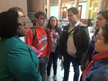 Pictured: Rep. Ammons (left) speaks with college students about the devastating effects cuts to higher education would have on their ability to complete their degrees.